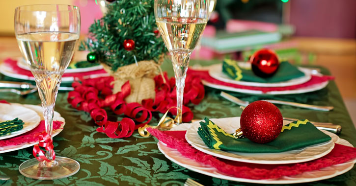 a festively decorated table setting