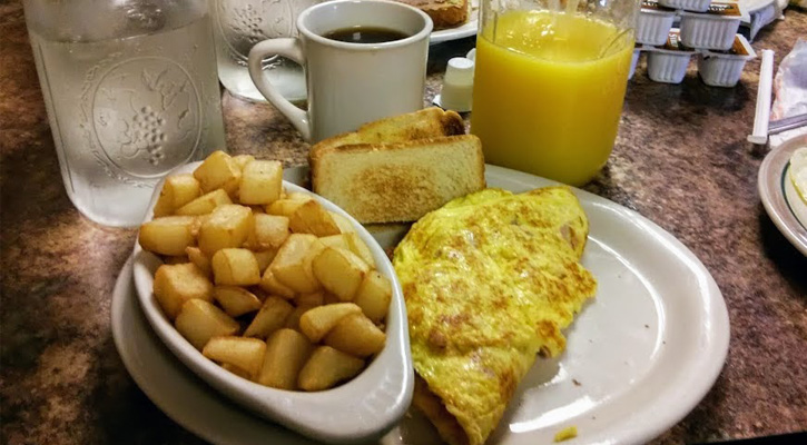 home fries, omelette, and orange juice