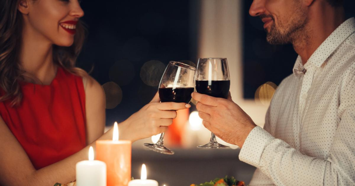 man and woman at dinner with wine