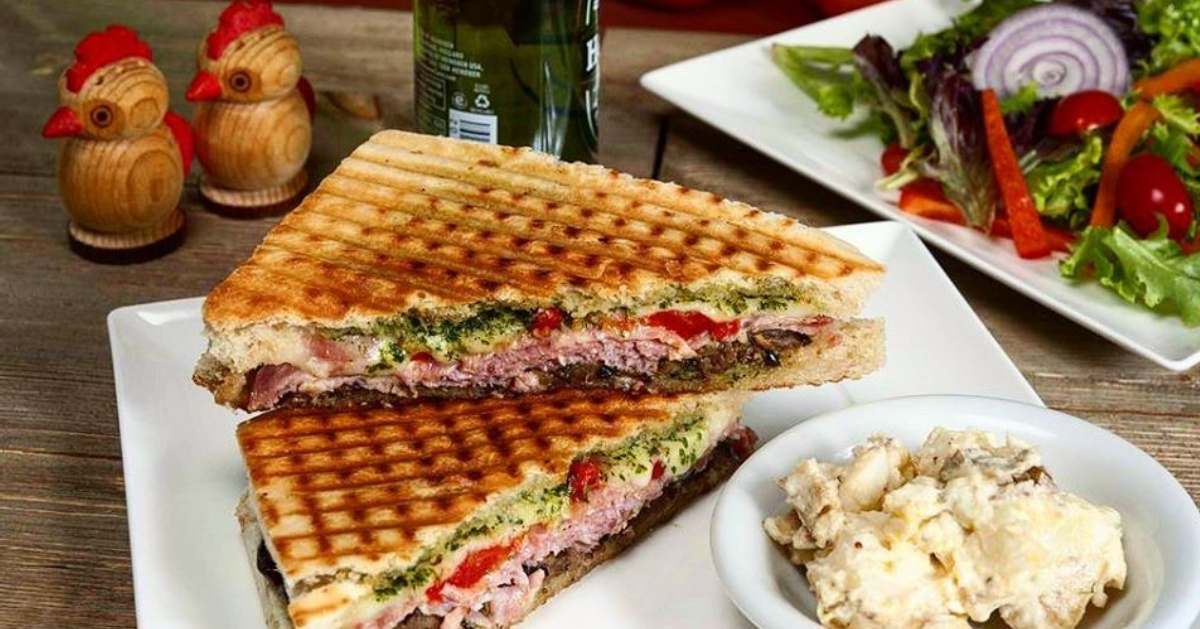 two halves of a panini on a plate