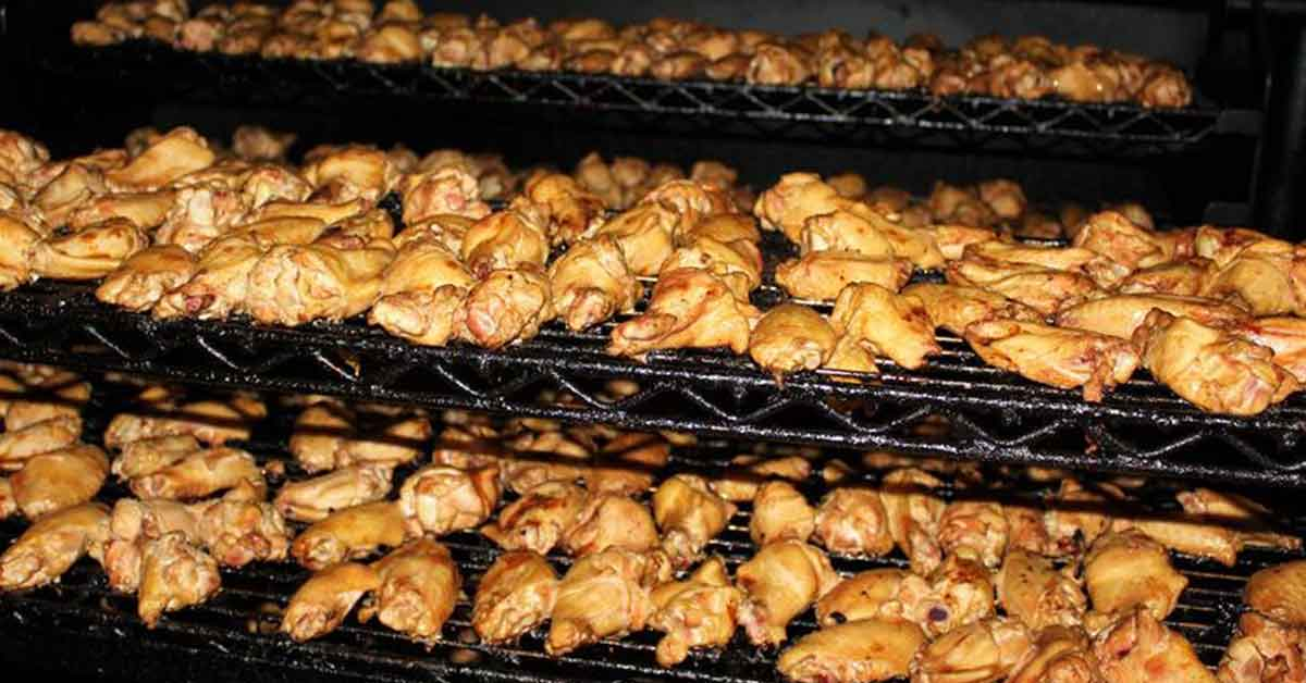 chicken wings being smoked