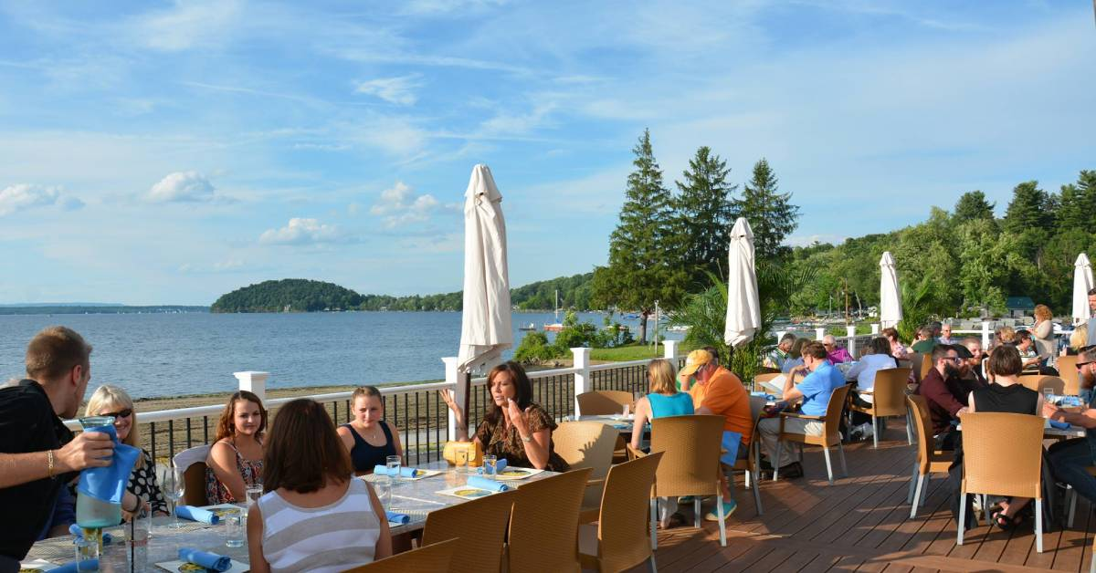 people dining on the lakeside patio at dock brown's