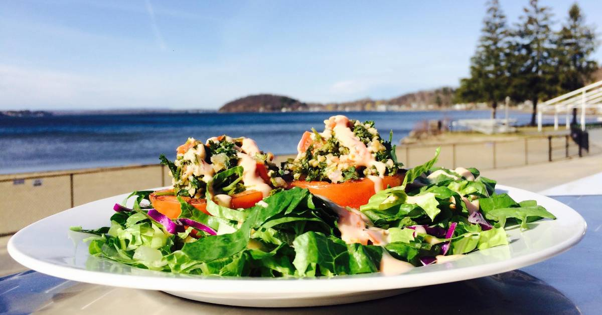 salad on a patio table near lake