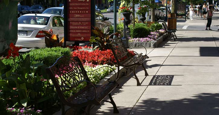 a street in downtown Saratoga with benches
