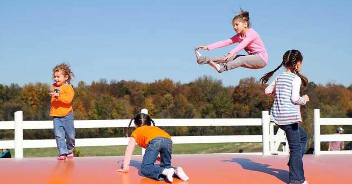 young kids on large orange jump pad