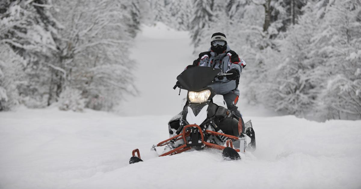 a snowmobiler in a snowy area