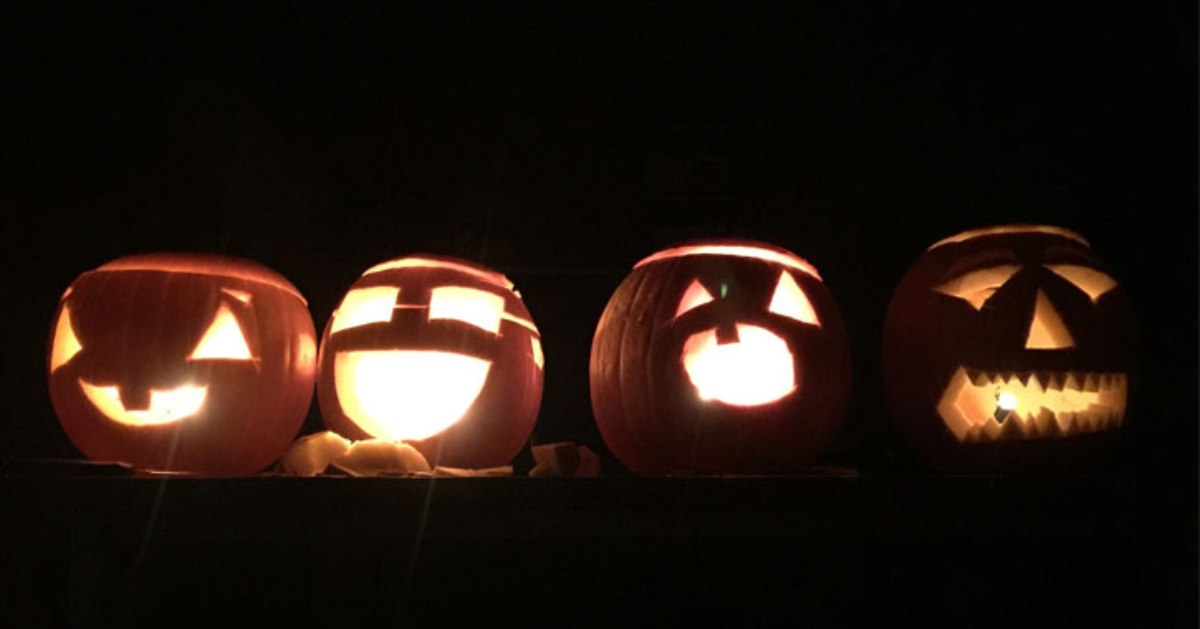 four jack o lanterns in a row