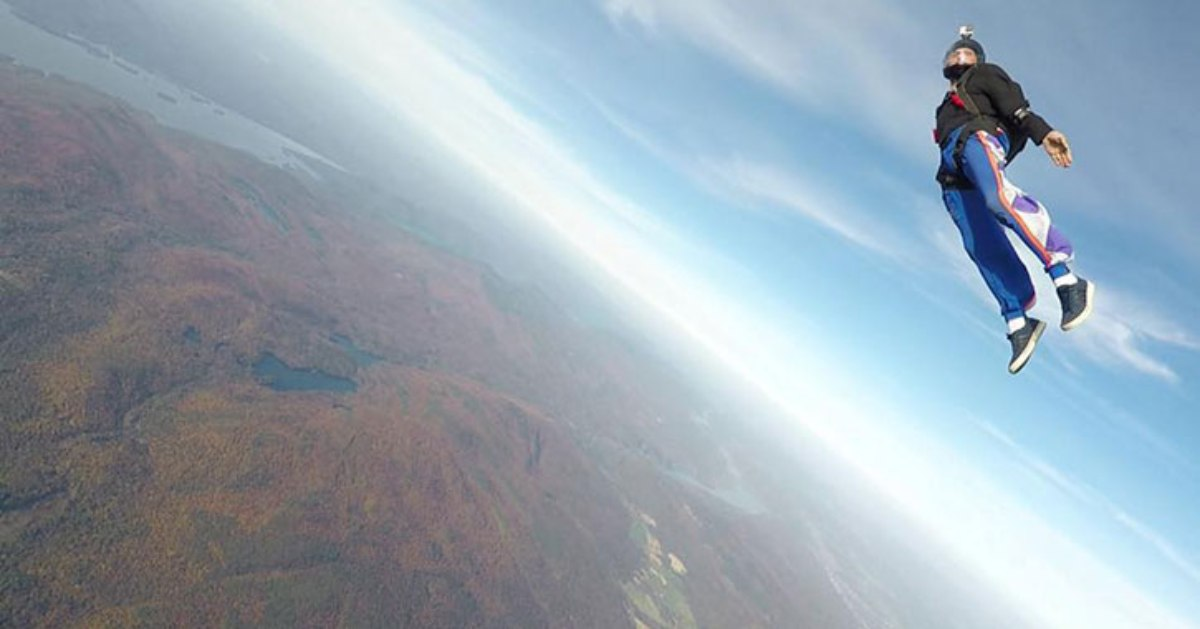 skydiver above fall landscape