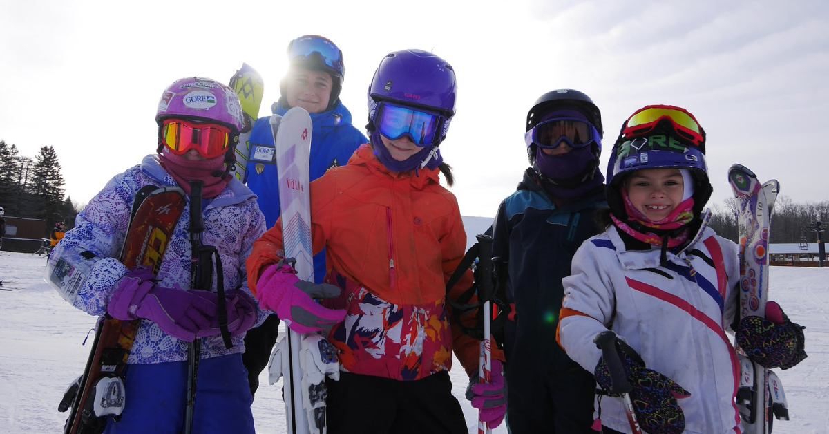 children posing with skis at gore mountain