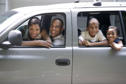 Family with Children Traveling in a Car