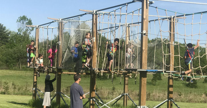 kids playing in a ropes course