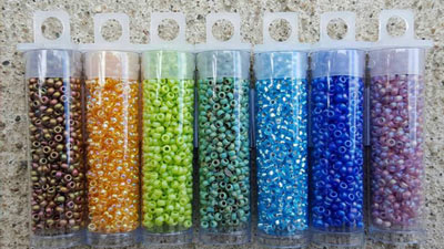 seven containers of beads