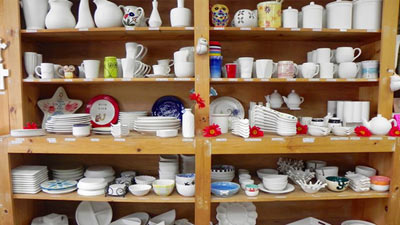 shelves full of pottery to paint