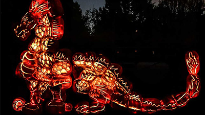 carved pumpkins in the shape of a dragon
