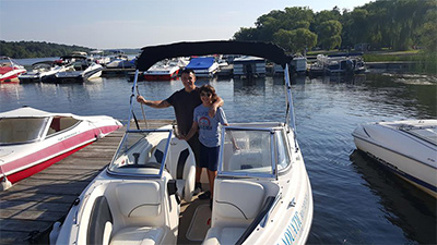 couple standing on a rental boat