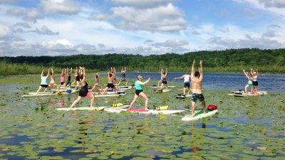 people doing sup yoga