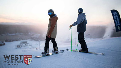 two people snowboarding and skiing at west mountain