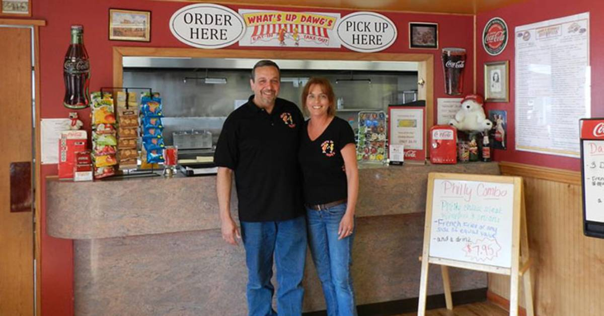 man and woman near hot dog counter