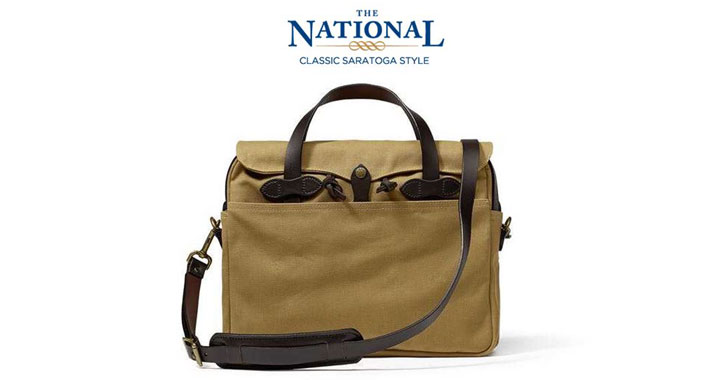 a beige and brown Filson bag with The National text above it