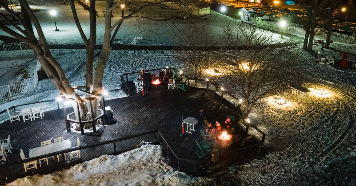 overhead view of people at fire pits on a patio