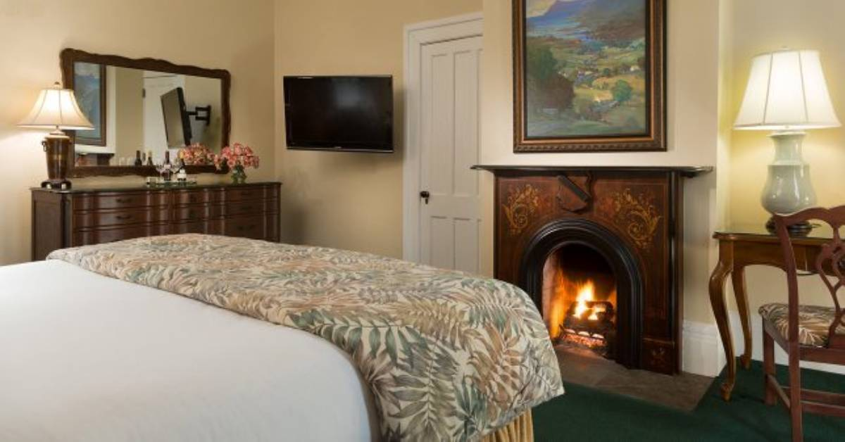 hotel with a bed and a fireplace