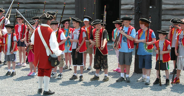 kids doing an activity with a reenactor at fort william henry