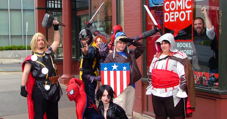 costumed characters in front of a comic book store