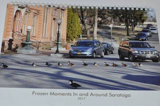 calendar with photo of ducks crossing a street