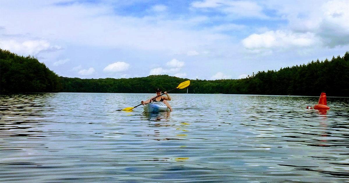 girl paddling in a kayak