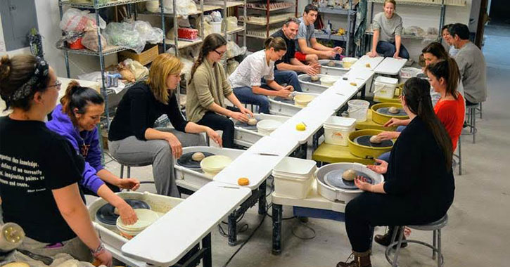group of people working with clay
