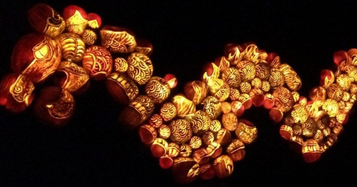 glowing orange dragon made of pumpkins