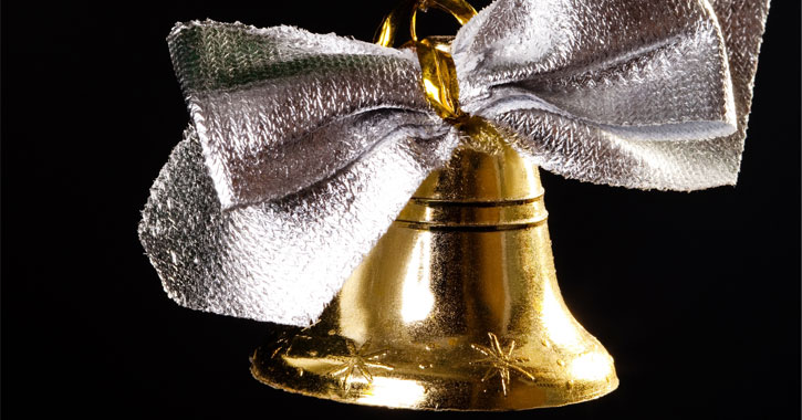gold bell with a silver bow