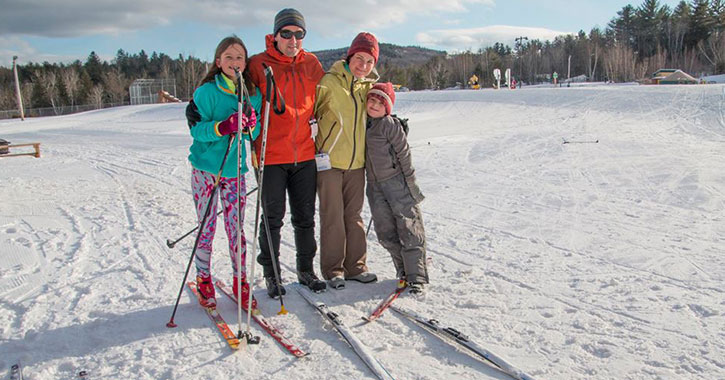 a family of four with cross country skis