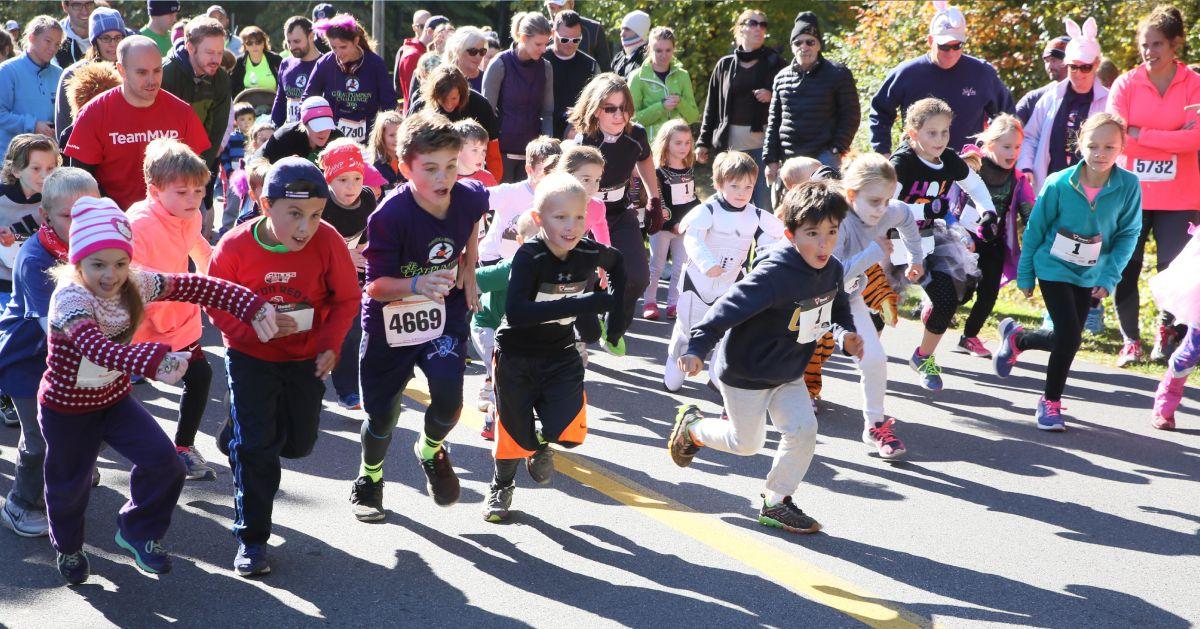 kids running down a road