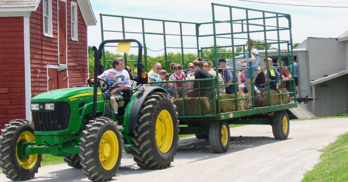 tractor pulling kids and people in wagon