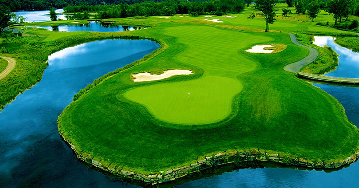 aerial view of a golf course with water