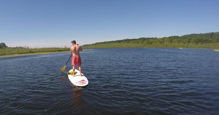 a guy paddleboarding