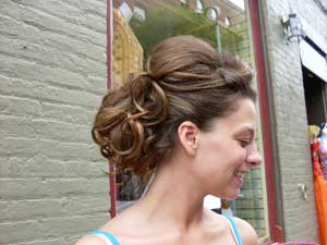 woman showing off her new updo