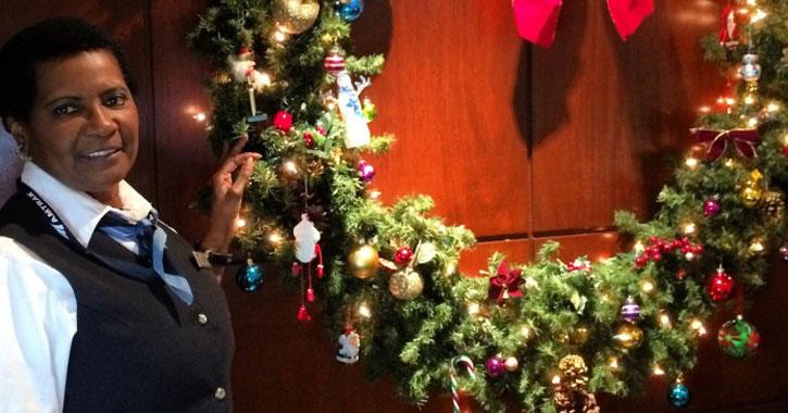 an Amtrak employee posing by a wreath