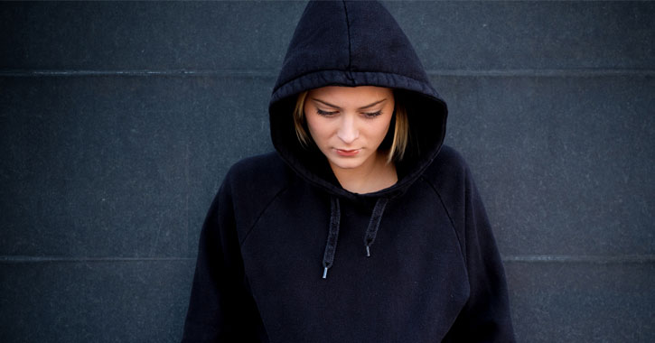 a girl in a navy blue hoodie