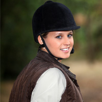young woman in horsebackriding outfit