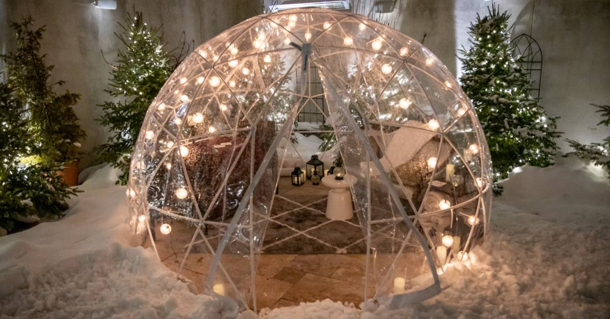 a dining igloo with snow around it