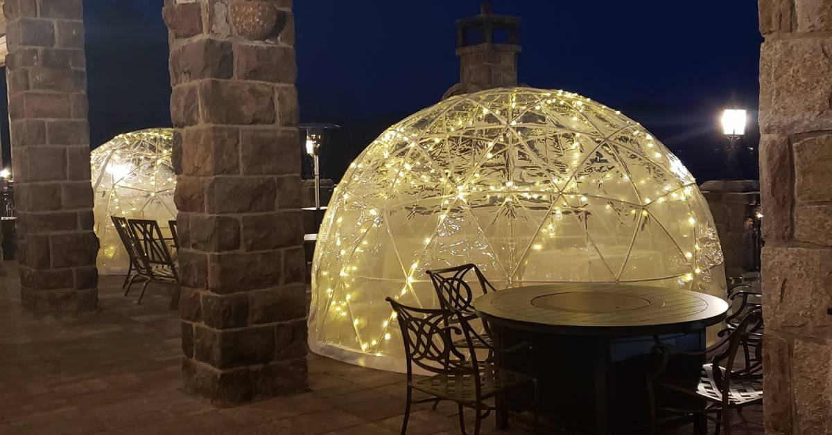 two dining igloos on a patio