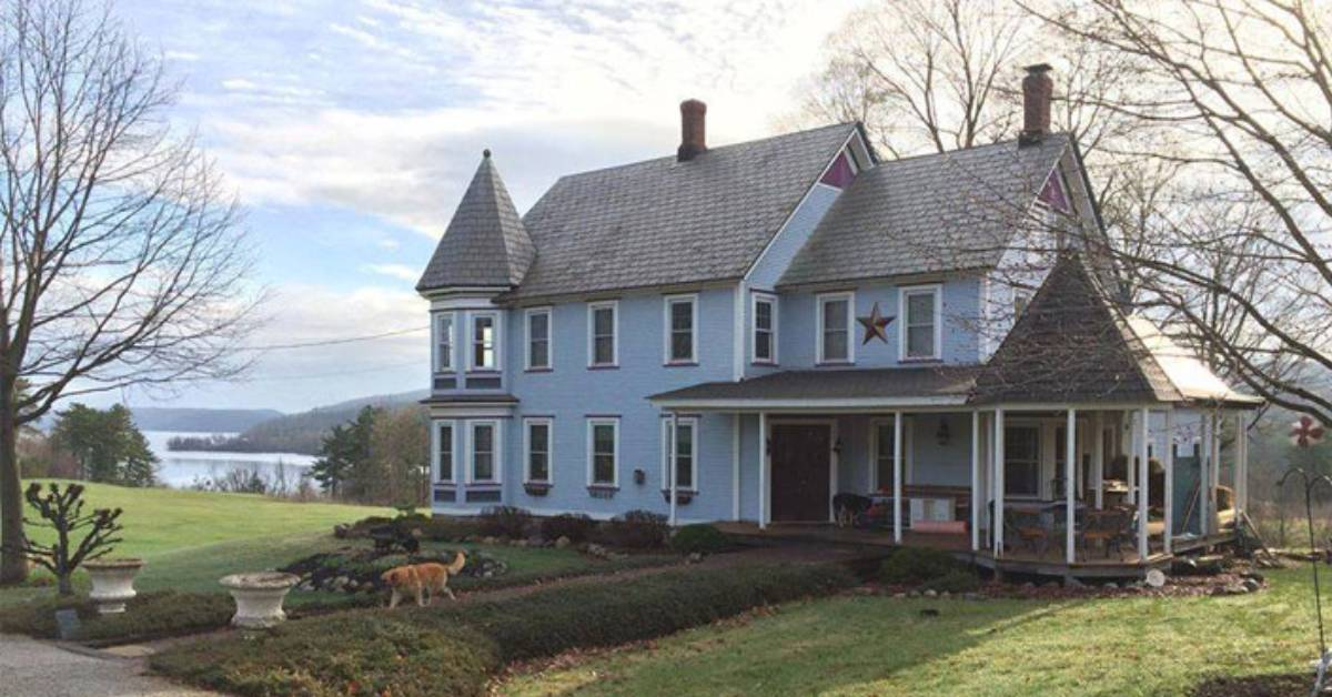 historic inn with dog walking on front path