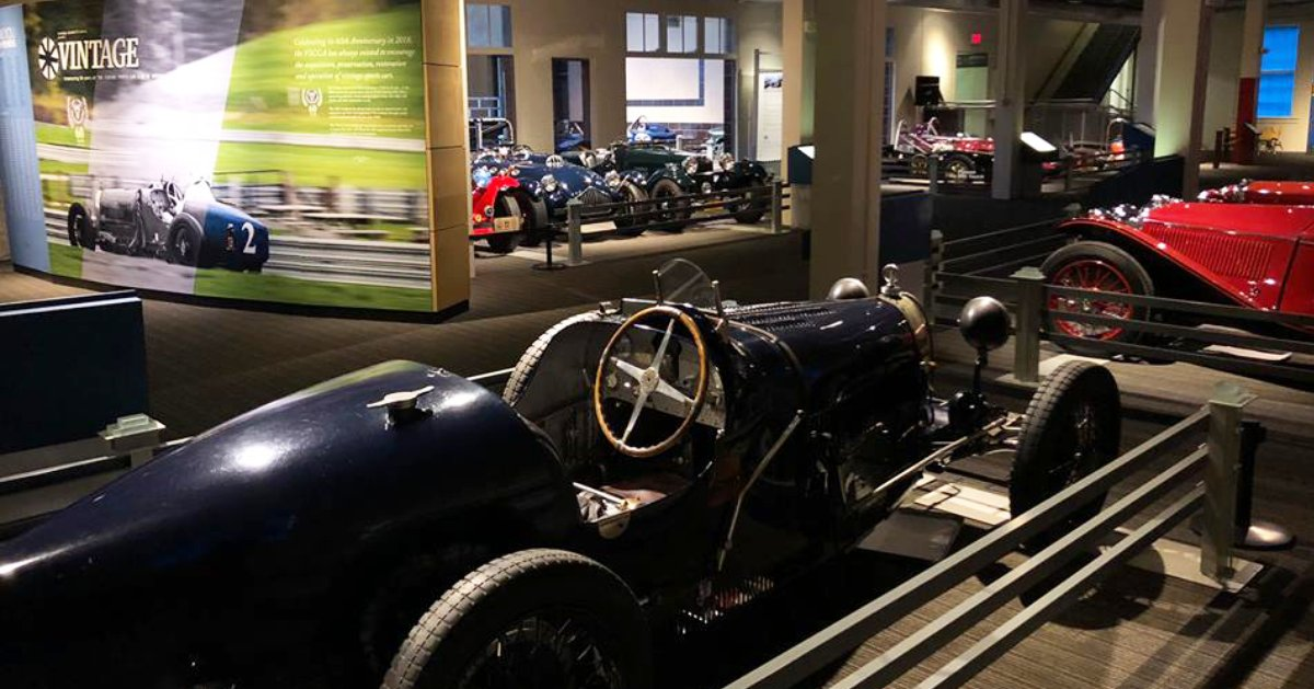 antique cars in a museum