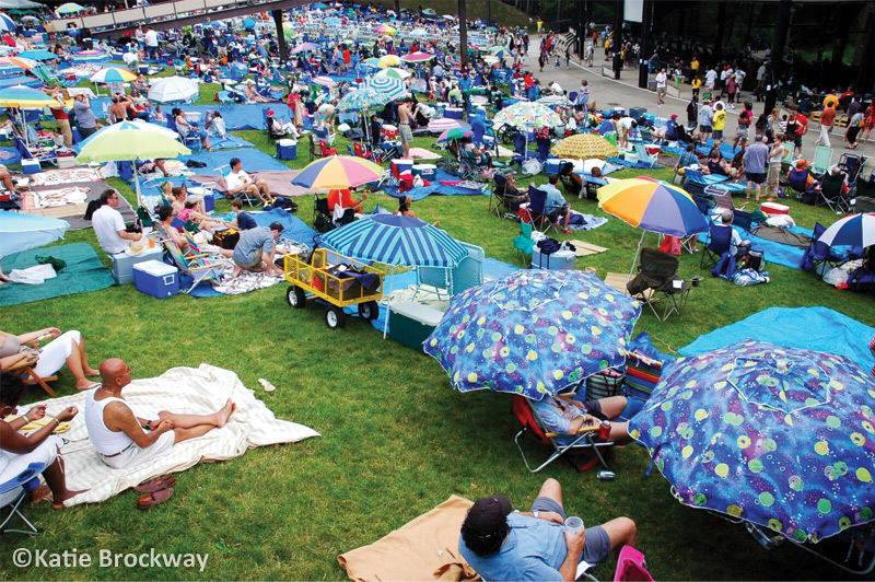 jazz festival attendees sitting on the lawn at spac