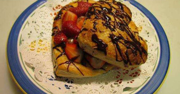 heart shaped pancakes with chocolate syrup on a plate