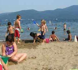kids at a beach on lake george