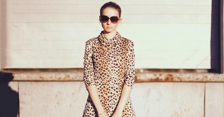a woman in a leopard print dress