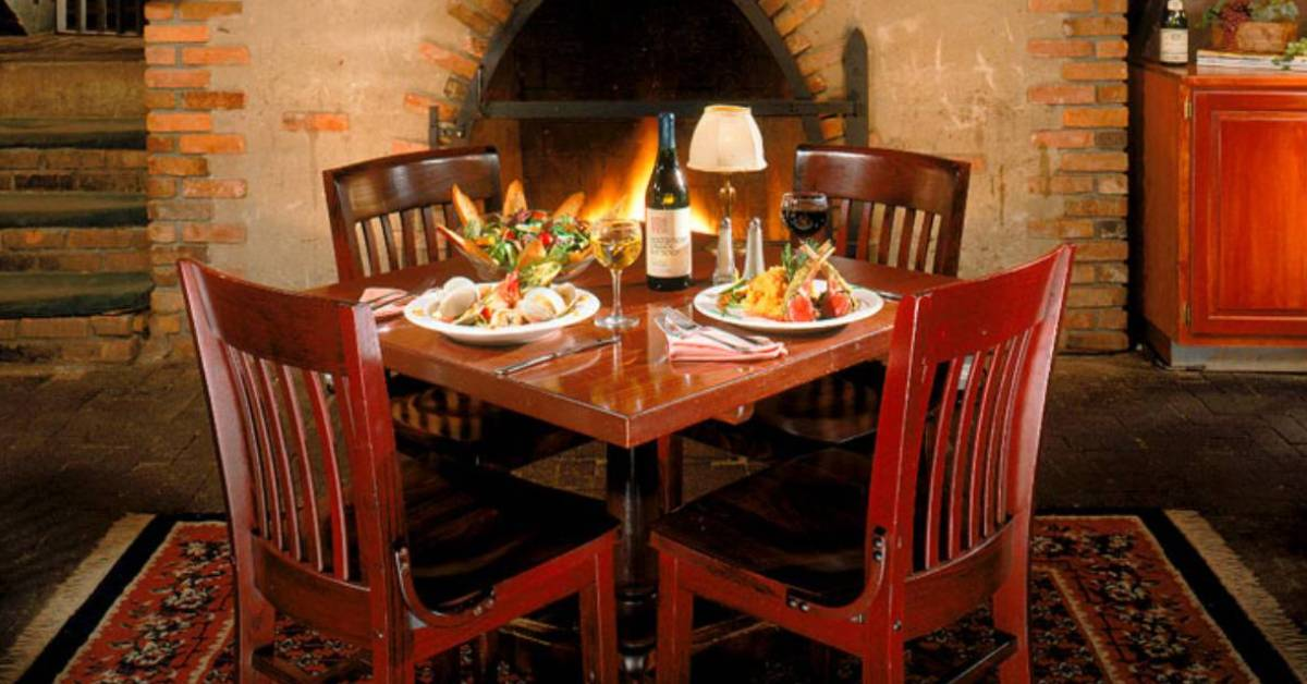 food and drinks on table by a fireplace
